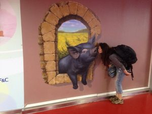 jenny is free, solo female traveller, and a mural at an airport in Jeju, Korea